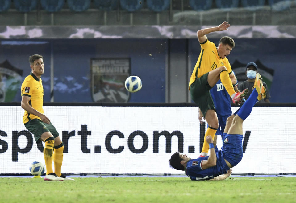 Kuwait's Shabaib Alkhaldi, right, fights for the ball with Australia's Ajdin Hrustic during the World Cup 2022 Group B qualifying soccer match between Kuwait and Australia in Kuwait City, Kuwait, Thursday, June 3, 2021. (AP Photo/Jaber Abdulkhaleg)
