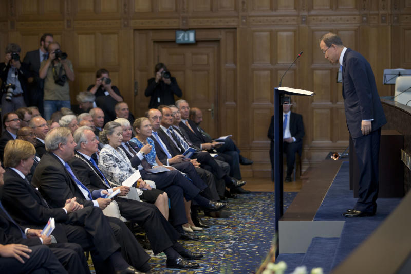 U.N. Secretary General Ban Ki-moon, right, bows to the guests prior to delivering a speech marking the 100th anniversary of the UN Peace Palace in The Hague, Netherlands, Wednesday Aug. 28, 2013. (AP Photo/Peter Dejong)