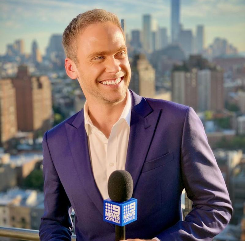 Channel 9's Tim Davies poses with microphone in Sydney
