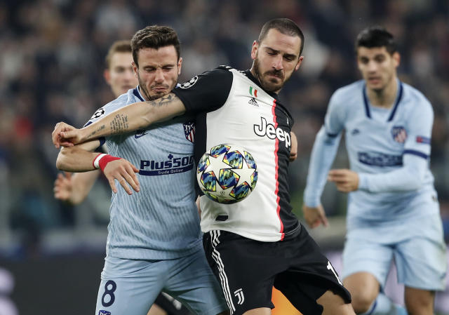 Juventus' Leonardo Bonucci, right, and Atletico Madrid's Saul Niguez challenge for the ball during the Champions League group D soccer match between Juventus and Atletico Madrid at the Allianz stadium in Turin, Italy, Tuesday, Nov. 26, 2019. (AP Photo/Antonio Calanni)