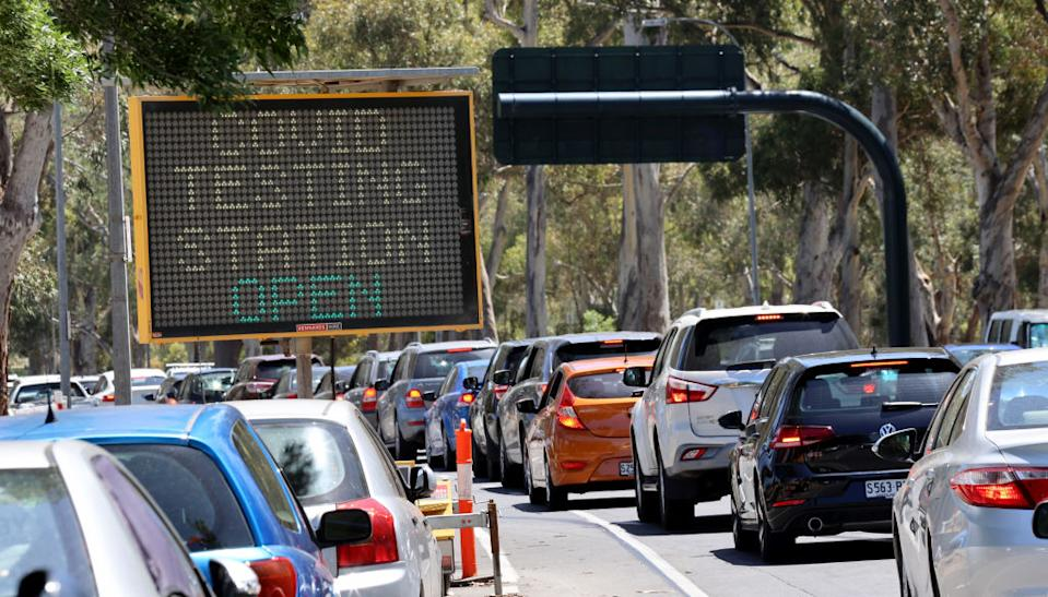 Cars queue for the Covid-19 testing facility at Victoria Park, just outside the Adelaide CBD.