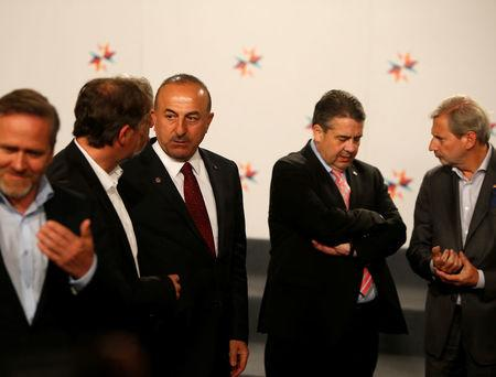 Turkey's Foreign Minister Mevlut Cavusoglu (3rd L) talks with Slovenia's Foreign Minister Karl Erjavec (2nd L), as German Foreign Minister Sigmar Gabriel (4th L) and European Commissioner Johannes Hahn (R) talk, after a meeting between European Union and candidate country Foreign Ministers in Valletta, Malta April 28, 2017.  REUTERS/Darrin Zammit Lupi