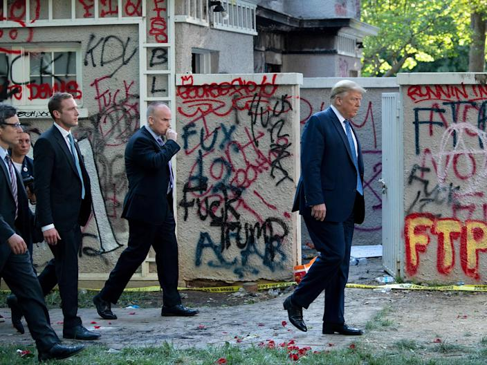 Donald Trump walks back to the White House escorted by the Secret Service after appearing outside of St John's Episcopal church  on June 1, 2020. (AFP via Getty Images)