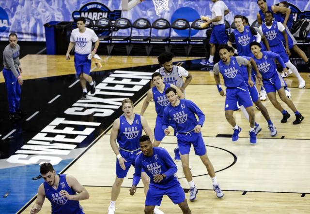 Duke players warm up at the beginning of practice at the NCAA men's college basketball tournament in Omaha, Neb., Thursday, March 22, 2018. Duke faces Syracuse in a regional semifinal on Friday. (AP Photo/Nati Harnik)