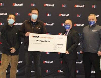 Dr. Chris Downing of Heartland Community Foundation accepting Brandt's $10,000 donation as part of their Thanks A Billion Holiday Fund (CNW Group/Brandt Group of Companies)