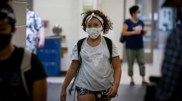 Students and staff will be required to wear masks indoors but not be vaccinated, according to the province's plan. (Evan Mitsui/CBC - image credit)