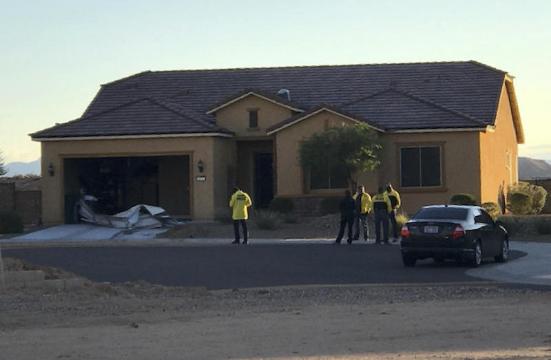 Police personnel stand outside the home of Stephen Paddock