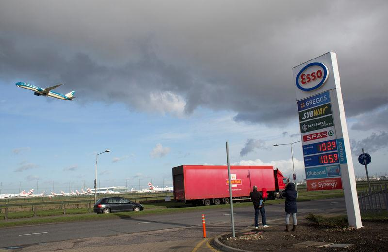 FILE PHOTO: An Esso service station displays the price of petrol and diesel at Heathrow airport, London January 30, 2016. REUTERS/Paul Hackett/File Photo