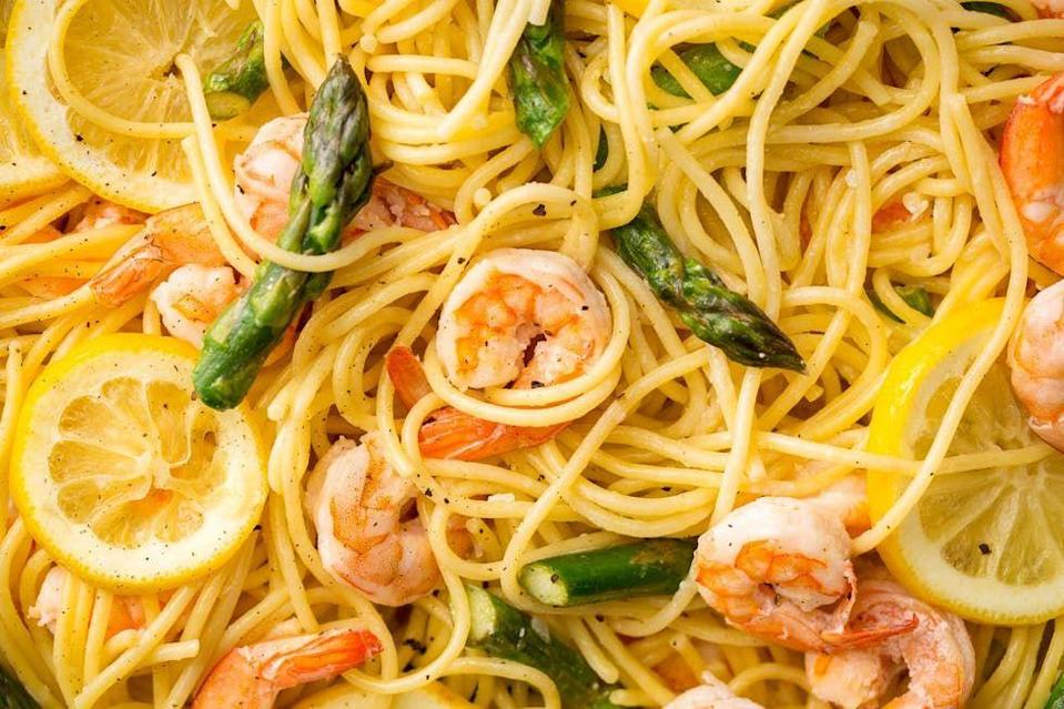 """<p>All the fresh flavours you crave in one super-easy spaghetti.</p><p>Get the <a href=""""https://www.delish.com/uk/cooking/recipes/a34421824/lemony-shrimp-and-asparagus-spaghetti-recipe/"""" rel=""""nofollow noopener"""" target=""""_blank"""" data-ylk=""""slk:Lemony Prawn and Asparagus Spaghetti"""" class=""""link rapid-noclick-resp"""">Lemony Prawn and Asparagus Spaghetti</a> recipe.</p>"""