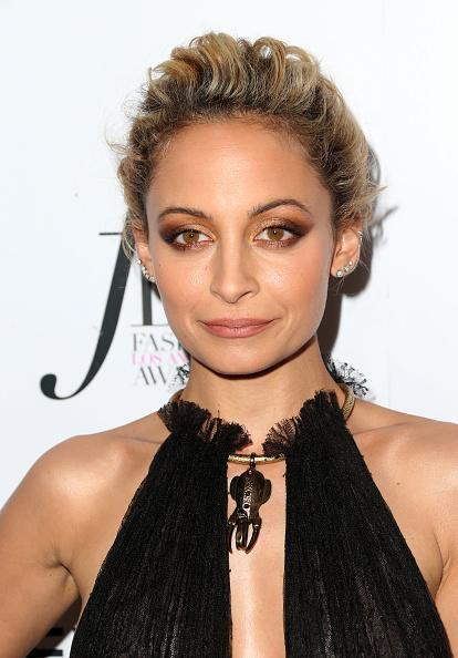 <p>Does Nicole Richie ever age? Her new short locks make her look younger than ever. [Photo: Getty] </p>