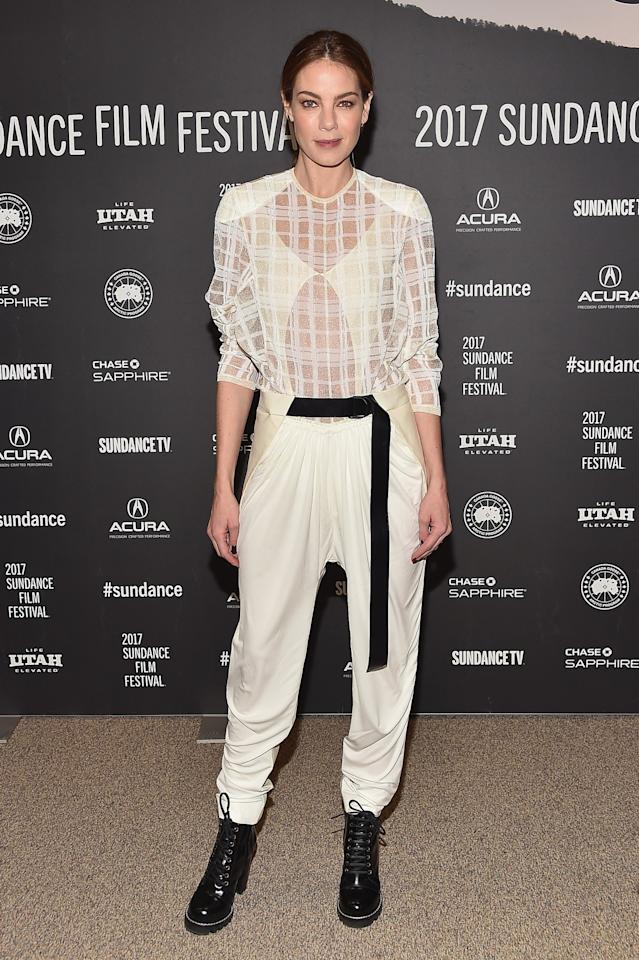 <p>Michelle went for a complete fashion risk in loose white trousers, a sheer top and Louis Vuitton boots. Yet it completely worked. <i>[Photo: Getty[</i> </p>