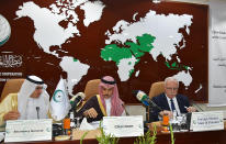 """FILE - In this Feb. 3, 2020, photo released by the the Organization of Islamic Cooperation (OIC), from right, Palestinian Foreign Minister Riyad al-Maliki, Saudi Foreign Minister Prince Faisal bin Farhan Al Saud, center, and the organization Secretary General, Yousef bin Ahmed Al-Othaimeen, chair an emergency ministerial meeting in Jiddah, Saudi Arabia. Days after Gulf Arab states expressed their support for President Donald Trump's efforts at resolving the Israeli-Palestinian conflict, representatives of Muslim-majority nations gathered in Saudi Arabia and rejected the White House's plan as """"biased."""" (Organization of Islamic Cooperation via AP)"""