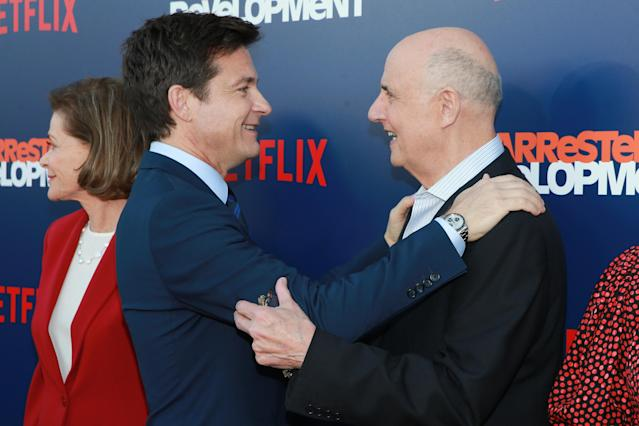 Jason Bateman made a point to give Jeffrey Tambor a big hug in front of photographers at the premiere of Netflix's <em>Arrested Development</em> Season 5 on May 17. (Photo: Rich Fury/Getty Images)
