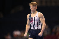 Shane Wiskus reacts after competing in the floor exercise during the men's U.S. Olympic Gymnastics Trials Thursday, June 24, 2021, in St. Louis. (AP Photo/Jeff Roberson)