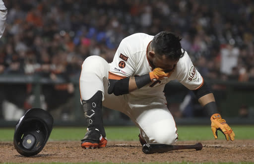 San Francisco Giants' Gerardo Parra falls to the ground after being hit by a pitch against the San Diego Padres during the seventh inning of a baseball game in San Francisco, Monday, April 8, 2019. (AP Photo/Jeff Chiu)
