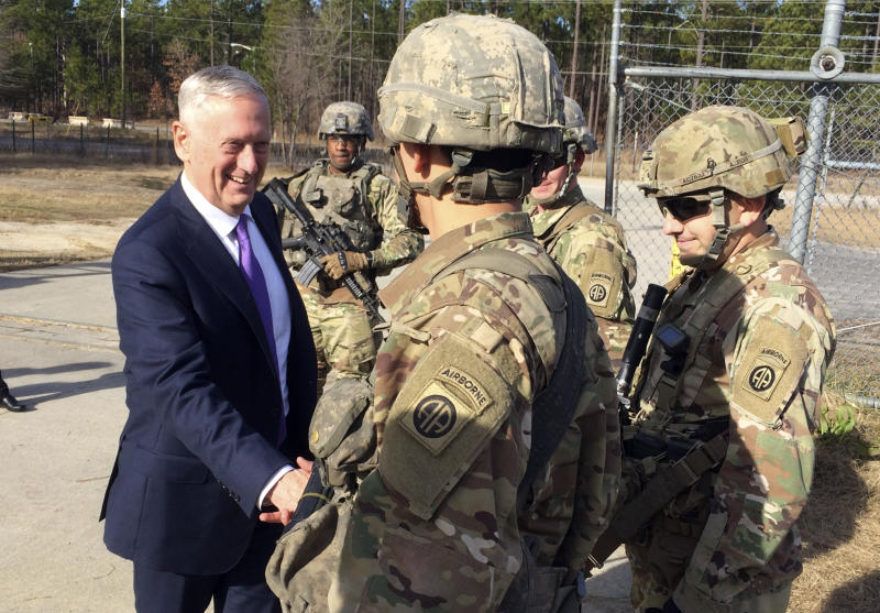 Defense Secretary Jim Mattis greets soliders at Fort Bragg, N.C., Friday, Dec. 22, 2017. (AP Photo/Robert Burns)