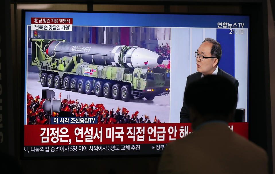 A man watches a TV screen during a news program reporting about the military parade to mark the 75th founding anniversary of the North Korea's ruling Workers' party, at the Seoul Railway Station in Seoul, South Korea, Saturday, Oct. 10, 2020. (AP Photo/Lee Jin-man)
