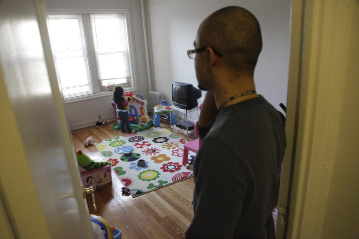 Christopher Astacio stands in the doorway watching, as his daughter Cristina, 2, recently diagnosed with a mild form of autism, plays in her bedroom on Wednesday, March 28, 2012 in New York. Autism cases are on the rise again, largely due to wider screening and better diagnosis, federal health officials said Thursday, March 2012. (AP Photo/Bebeto Matthews)