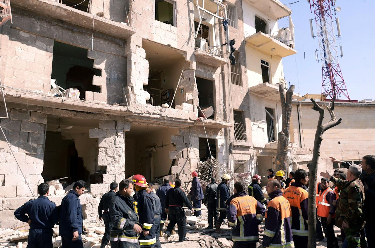"This photo released by the Syrian official news agency SANA shows Syrian rescue teams investigating the scene after an explosion in Aleppo, Syria, Sunday, March 18, 2012. An explosion ripped through a residential neighborhood in the northern Syrian city of Aleppo on Sunday and the state news agency said it was a ""terrorist bombing."" The report by SANA gave no information on casualties in what appeared to be the second attack in two days on cities where President Bashar Assad's regime enjoys strong support. (AP Photo/SANA)"
