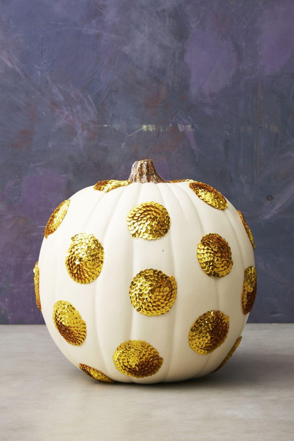 """<p>Add some sparkle to your front porch with these ultra-glam pumpkins. To make, glue 1- to 2-inch sequin circles on the pumpkin and repeat until the pumpkin is glitzy enough for your taste.</p><p> <a class=""""link rapid-noclick-resp"""" href=""""https://www.amazon.com/PH-PandaHall-100yards-Paillette-Embellish/dp/B07NC5XYFC/?tag=syn-yahoo-20&ascsubtag=%5Bartid%7C10055.g.2592%5Bsrc%7Cyahoo-us"""" rel=""""nofollow noopener"""" target=""""_blank"""" data-ylk=""""slk:SHOP SEQUINS"""">SHOP SEQUINS</a></p>"""