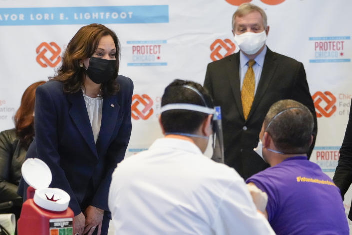 Vice President Kamala Harris talks with Lucio Polanco, a high-rise window washer, as he gets the Johnson & Johnson COVID-19 vaccination from Osman Meah at COVID-19 vaccination site, Tuesday, April 6, 2021, in Chicago. Watching are Sen. Tammy Duckworth, D-Ill., left, and Sen. Dick Durbin, D-Ill. The site is a partnership between the City of Chicago and the Chicago Federation of Labor. (AP Photo/Jacquelyn Martin)