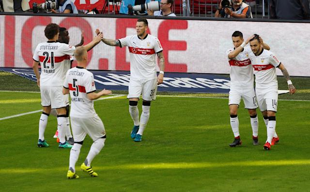 Soccer Football - Bundesliga - Bayern Munich v VfB Stuttgart - Allianz Arena, Munich, Germany - May 12, 2018 Stuttgart's Daniel Ginczek celebrates scoring their first goal with team mates REUTERS/Michaela Rehle DFL RULES TO LIMIT THE ONLINE USAGE DURING MATCH TIME TO 15 PICTURES PER GAME. IMAGE SEQUENCES TO SIMULATE VIDEO IS NOT ALLOWED AT ANY TIME. FOR FURTHER QUERIES PLEASE CONTACT DFL DIRECTLY AT + 49 69 650050