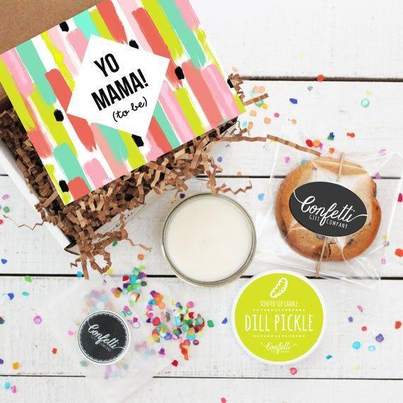 """<p><strong>ConfettiGiftCompany</strong></p><p>etsy.com</p><p><strong>$28.00</strong></p><p><a href=""""https://go.redirectingat.com?id=74968X1596630&url=https%3A%2F%2Fwww.etsy.com%2Flisting%2F512434931%2Fmini-yo-mama-to-be-gift-box-pregnancy&sref=https%3A%2F%2Fwww.womansday.com%2Frelationships%2Ffamily-friends%2Fg3271%2Fgifts-for-pregnant-women%2F"""" rel=""""nofollow noopener"""" target=""""_blank"""" data-ylk=""""slk:Shop Now"""" class=""""link rapid-noclick-resp"""">Shop Now</a></p><p>Satisfy her pregnancy cravings and have a little bit of fun with this gift box that comes with a pickle-scented candle and some soft, chewy chocolate chip cookies. </p>"""