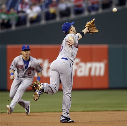 New York Mets third baseman David Wright, right, cannot reach a single by Philadelphia Phillies' Juan Pierre in the first inning of a baseball game, Wednesday, May 9, 2012, in Philadelphia. At left is shortstop Justin Turner. (AP Photo/Matt Slocum)
