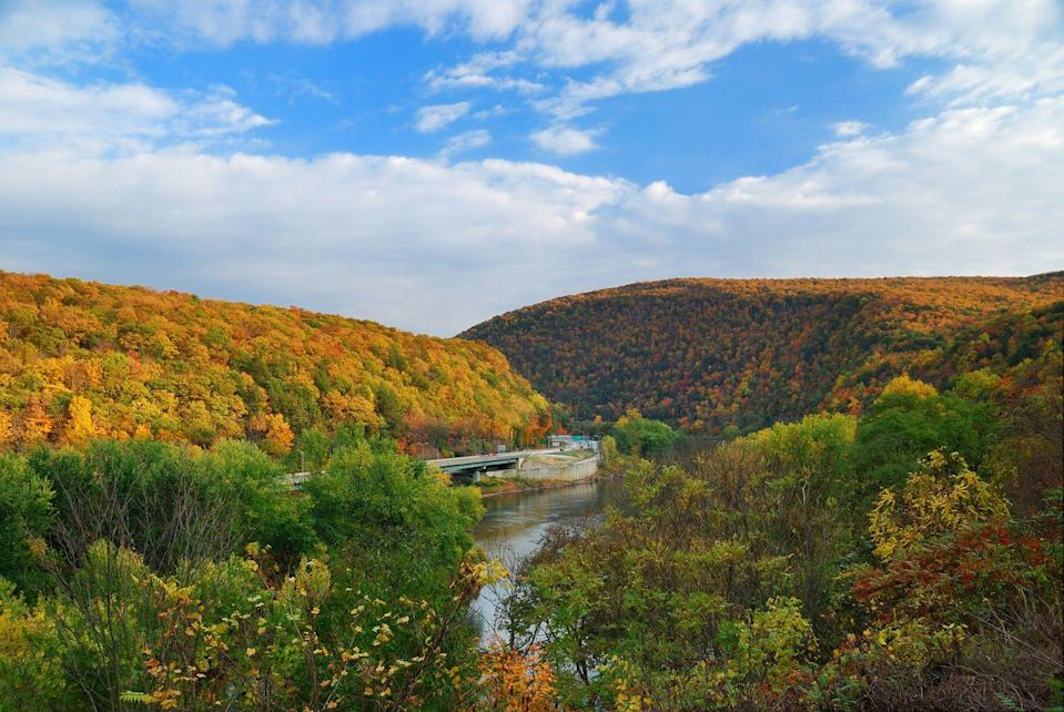 """<p>The Poconos mountains are a popular spot for leaf-peeping, which is why the area's tourism actually begins <a href=""""https://www.poconomountains.com/seasons/fall-in-the-pocono-mountains/fall-foliage-forecast/"""" rel=""""nofollow noopener"""" target=""""_blank"""" data-ylk=""""slk:a foliage forecast"""" class=""""link rapid-noclick-resp"""">a foliage forecast</a> in the first week of September to alert aspiring travelers of the best time to arrive. Last year, <a href=""""https://assets.simpleviewinc.com/simpleview/image/upload/v1/clients/poconos/1st_FFF_Report_2019_d7932bce-7f7a-49bd-83de-22a754d6c52f.png"""" rel=""""nofollow noopener"""" target=""""_blank"""" data-ylk=""""slk:mid-October offered peak color"""" class=""""link rapid-noclick-resp"""">mid-October offered peak color</a>, which you could gaze warmly from the inside of a train car on the <a href=""""https://www.poconomountains.com/event/pocono-foliage-express/19312/"""" rel=""""nofollow noopener"""" target=""""_blank"""" data-ylk=""""slk:Poconos Foliage Express"""" class=""""link rapid-noclick-resp"""">Poconos Foliage Express</a>.</p>"""