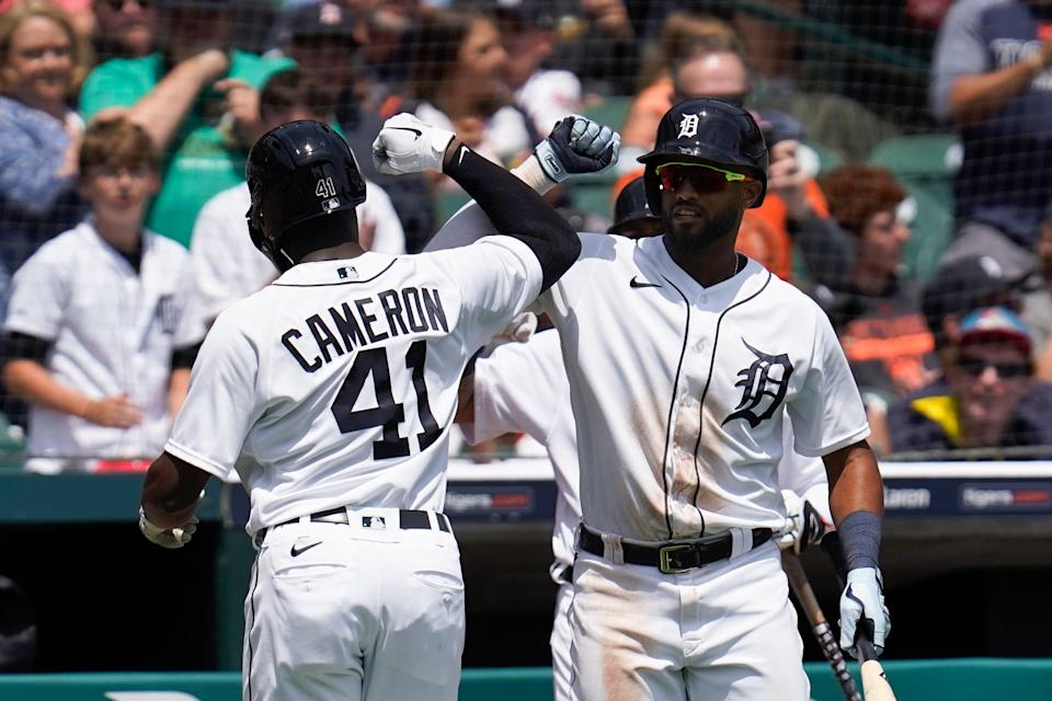 Detroit Tigers' Daz Cameron (41) celebrates his solo home run with Willi Castro against the St. Louis Cardinals in the fourth inning of a baseball game in Detroit, Wednesday, June 23, 2021.