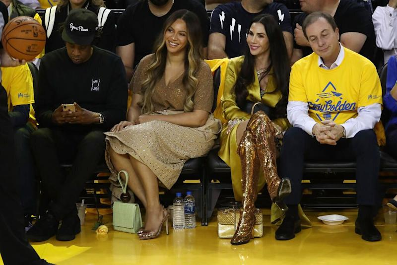 Jay-Z and Beyoncé sit courtside with Nicole Curran and Golden State Warriors owner Joe Lacob at an NBA Finals game between the Warriors and the Toronto Raptors at Oracle Arena on June 5 in Oakland, California. (Photo: Ezra Shaw/Getty Images)