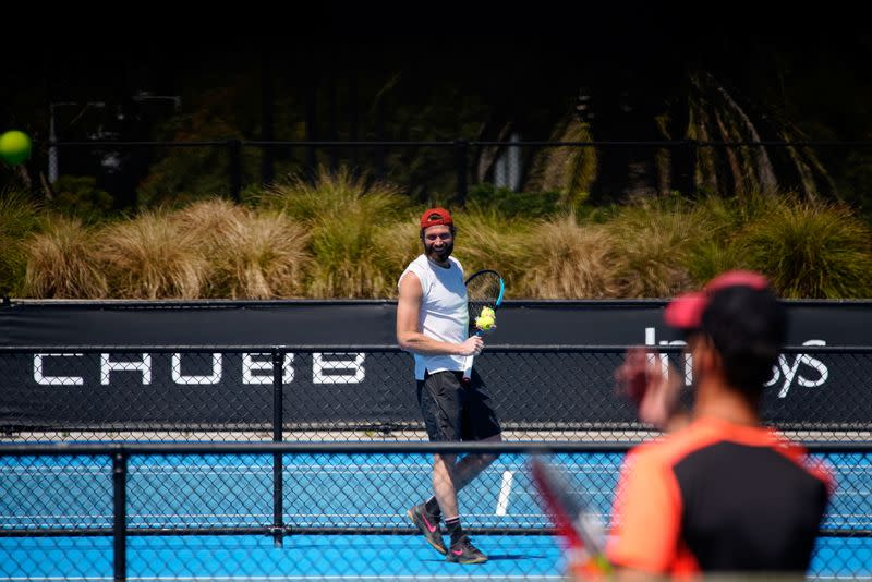Quarantined Australian Open tennis players train in a restricted area in Melbourne