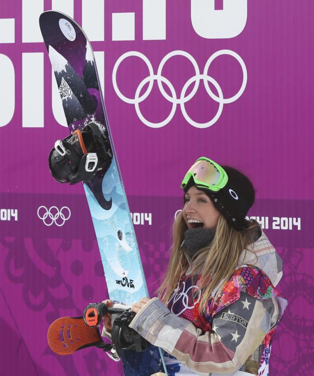 CORRECTS TO SAY THAT ANDERSON CELEBRATES HER SCORE. SHE HAD NOT YET LEARNED THAT SHE WON THE COMPETITION - Jamie Anderson of the United States celebrates her score after completing her run in the women's snowboard slopestyle final at the 2014 Winter Olympics, Sunday, Feb. 9, 2014, in Krasnaya Polyana, Russia. Anderson won the gold in a near flawless run. (AP Photo/Sergei Grits)