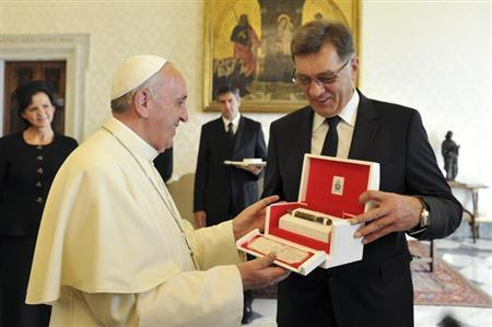 Pope Francis exchanges gifts with Prime Minister of Lithuania Butkevicius during private audience at the Vatican