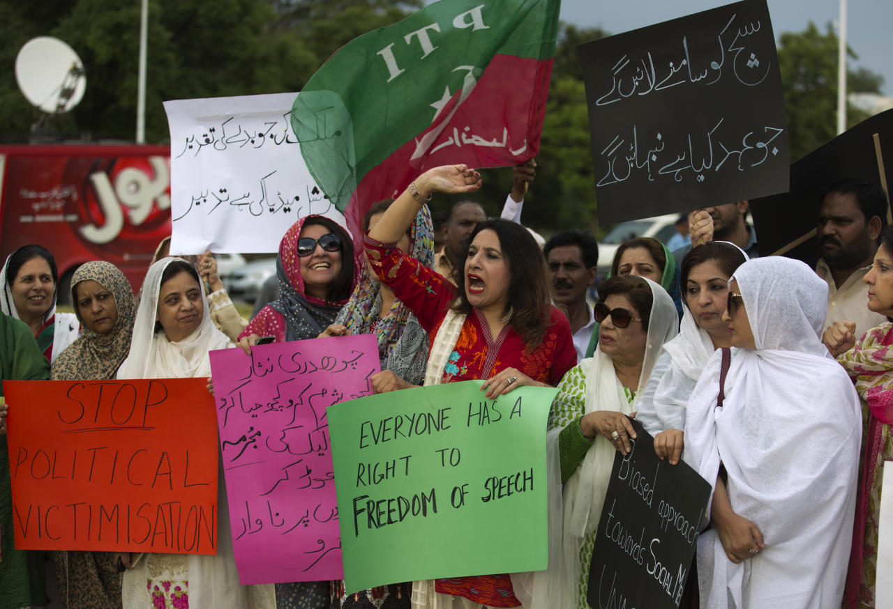 "Supporters of Pakistan's political party Tehreek-e-Insaf protest against curbing of freedom of expression through social media in Islamabad, Pakistan, Monday, May 22, 2017. Pakistani security agencies investigating dozens of people for posting anti-state content on various social media websites. Placard on right reads ""We will highlight truth, we promise."" (AP Photo/B.K. Bangash)"