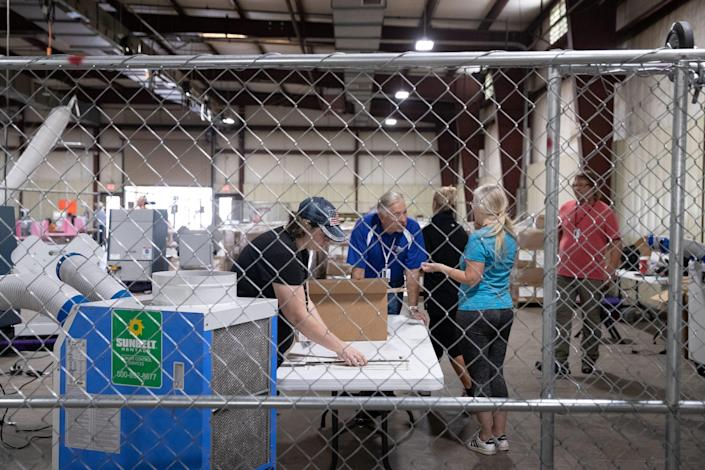 The audit of the Maricopa County ballots from the 2020 general election continues on July 14, 2021, in the Wesley Bolin Building at the Arizona State Fairgrounds in Phoenix.