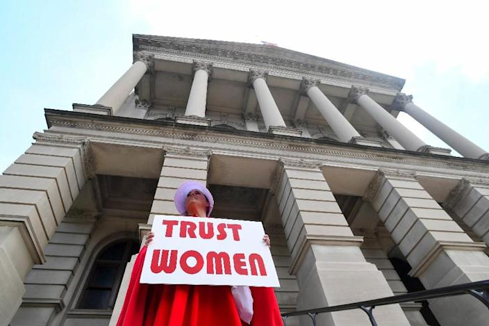 An abortion rights demonstrator stands outside the Georgia Capitol in Atlanta on May 16, 2019 to protest a draconian new abortion law in neighboring Alabama (AFP Photo/John Amis)