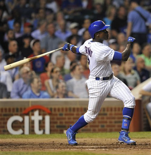 Chicago Cubs' Alfonso Soriano watches his sacrifice fly against the Cincinnati Reds during the fourth inning of a baseball game on Tuesday, June 11, 2013, in Chicago. (AP Photo/Jim Prisching)