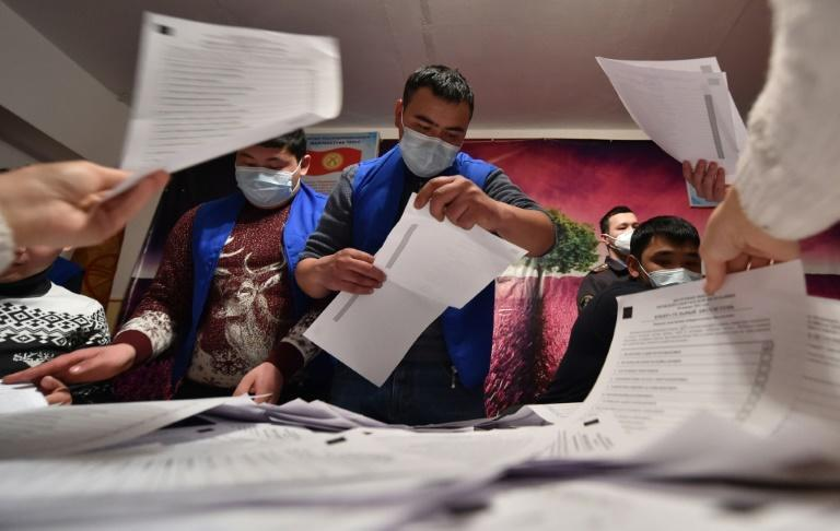 Members of a local electoral commission count votes in the village of Arashan outside Bishkek