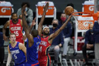 New Orleans Pelicans forward Brandon Ingram (14) shoots next to Los Angeles Clippers center Serge Ibaka (9) during the first quarter of an NBA basketball game Wednesday, Jan. 13, 2021, in Los Angeles. (AP Photo/Ashley Landis)