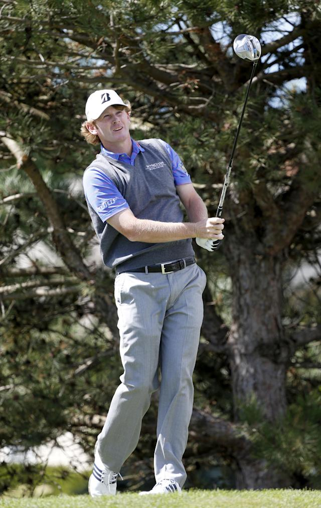 Brandt Snedeker watches his tee shot on the fourth hole during the second round of the BMW Championship golf tournament at Conway Farms Golf Club in Lake Forest, Ill., Friday, Sept. 13, 2013. (AP Photo/Charles Rex Arbogast)
