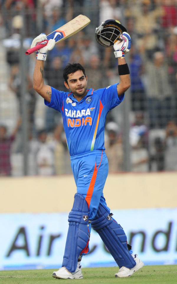 Indian batsman Virat Kohli reacts after scoring a century (100 runs) during the one day international (ODI) Asia Cup cricket match between India and Sri Lanka at The Sher-e-Bangla National Cricket Stadium in Dhaka on March 13, 2012. AFP PHOTO/Munir uz ZAMAN (Photo credit should read MUNIR UZ ZAMAN/AFP/Getty Images)