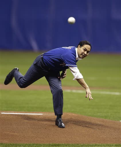 San Antonio Mayor Julian Castro throws out the first pitch prior to an exhibition baseball game between the Texas Ranges and the San Diego Padres, Friday, March 29, 2013, in San Antonio. (AP Photo/Eric Gay)