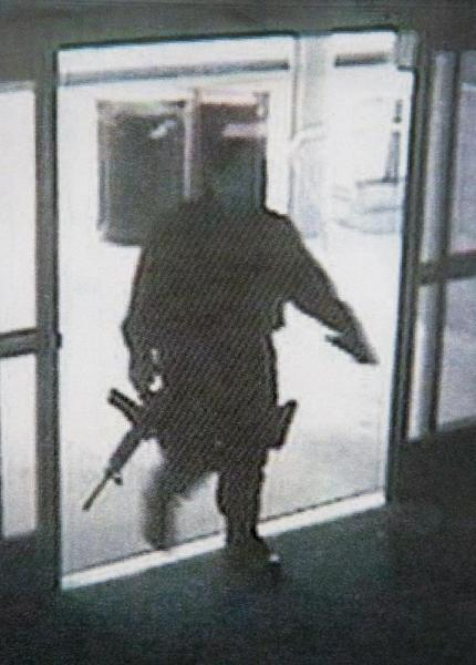 In this file photo provided by the Santa Monica Police Department during a news conference Saturday, June 8, 2013, shows a video frame grab from a surveillance camera revealing the suspect entering Santa Monica College Friday, in Santa Monica, Calif. The Police chief said Saturday that the gunman who went on a chaotic rampage killing four people before being fatally shot by police at the college planned the attack and was capable of firing 1,300 rounds of ammunition. (AP Photo/Santa Monica Police Department, File)