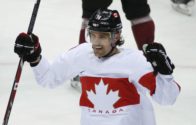 Canada forward Patrick Sharp reacts after scoring a goal against Latvia during the first period of a men's quarterfinal ice hockey game at the 2014 Winter Olympics, Wednesday, Feb. 19, 2014, in Sochi, Russia. (AP Photo/Mark Humphrey)