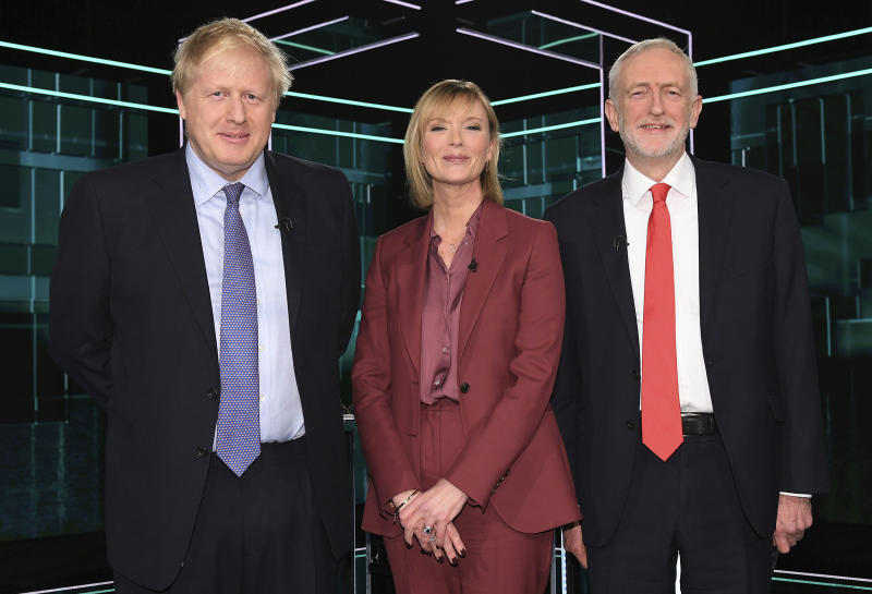 In this photo issued by ITV, showing Boris Johnson, left, and Jeremy Corbyn, right, with TV debate adjudicator Julie Etchingham, prior to their election head-to-head debate live on TV, in Manchester, England, Tuesday, Nov. 19, 2019.  Prime Minister Boris Johnson and Jeremy Corbyn are set to go head-to-head in their first live televised debate Tuesday evening, as the UK prepares for a General Election on Dec. 12. (ITV via AP)