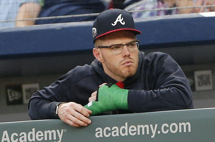 Injured Atlanta Braves first baseman Freddie Freeman (5) wears a cast on his wrist as he watches a baseball game against the Toronto Blue Jays Thursday, May 18, 2017, in Atlanta. Freeman was hit by a pitch the pervious night and is expected to miss up to ten weeks. (AP Photo/John Bazemore)