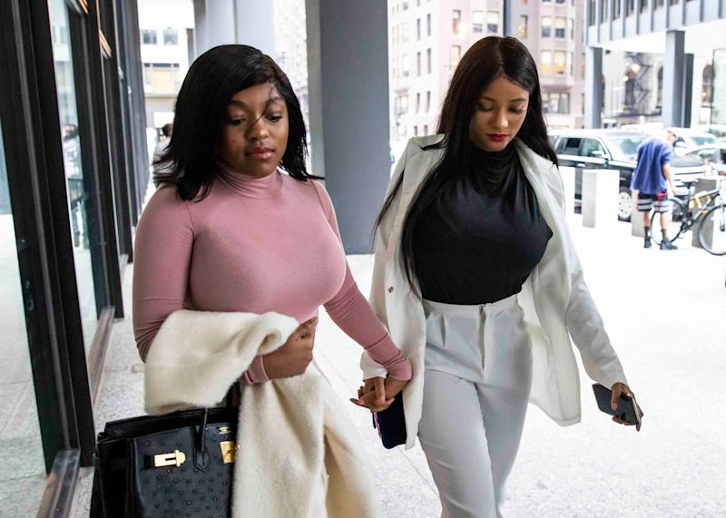 Azriel Clary, left, and Joycelyn Savage, girlfriends of R. Kelly, walk into federal courthouse in Chicago for his hearing, July 16, 2019.