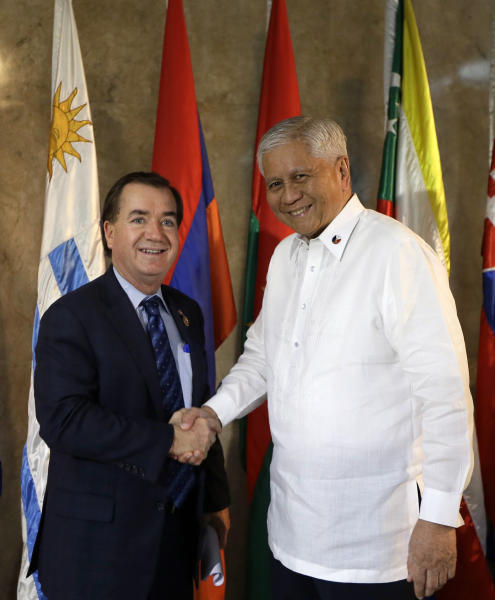 Philippine Foreign Affairs Secretary Albert Del Rosario greets visiting U.S. Rep. Edward Royce, R-Calif., Chair of the House Committee on Foreign Affairs, prior to his delegation's meeting Tuesday, Jan. 29, 2013, in Manila, Philippines. Royce and five members of his delegation are in Manila for talks with top Philippine officials, including President Benigno Aquino III, aimed at strengthening relations between the two countries. (AP Photo/Bullit Marquez)