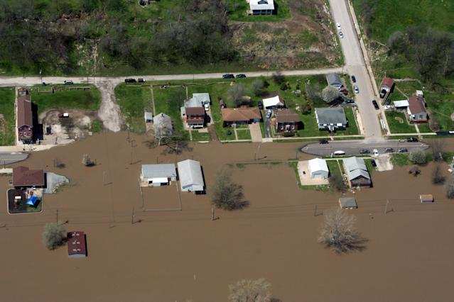 This Saturday, April 20, 2013, photo, provided by the Missouri Department of Public Safety shows flooding in LaGrange, Mo. The Mississippi River is topping out at some problematic spots, but there is growing concern that spring floods are far from over. The river was at or near crest at several places Sunday, April 21, 2013 between the Quad Cities and near St. Louis. Some towns in the approximate 100-mile stretch of river from Quincy, Ill., to Grafton, Ill., reached 10-12 feet above flood stage. (AP Photo/Missouri Department of Public Safety)